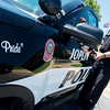 Globe/Roger Nomer<br /> Joplin Police Officer Logan Rivers enters a Joplin Police Ford Explorer on Wednesday.