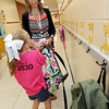 Kindergarten teacher Chelsey Junker helps six-year-old Regan Harper find a hook for her backpack on the first day of school on Thursday at Jefferson Elementary.<br /> Globe | Laurie Sisk