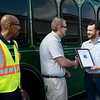 Globe/Roger Nomer<br /> Joplin City Councilmember Taylor Brown presents Robert Lolley, transit director, center, and Terry Wright, transit driver supervisor, with the Federal Transit Administration Region 7 Award of Excellence on Tuesday.