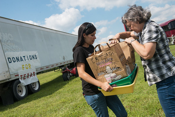 Globe/Roger Nomer<br /> Ashley Going receives donations from Bobbie Hill, Carthage, for Hurricane Harvey victims on Thursday in Carthage.