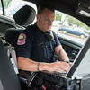 Globe/Roger Nomer<br /> Joplin Patrolman Brian Leeper works on Tuesday morning in Joplin.