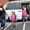 From the left: Jayme Harper gathers her triplets, Lauren, Regan and Addison as they arrive for their first day of kindergarten on Thursday at Jefferson Elementary. Born five days before the May 2011 tornado, the girls have dealt with a variety of health issues as they prepare to start their educational careers.<br /> Globe | Laurie Sisk
