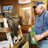 "Longtime collector W.G. ""Trip"" Triplett, of Circle T Collectibles in Carl Junction, stands near a 1944 German Mounted Infantry Saddle on Wednesday at his shop. Triplett began collecting Native American and military artifacts 71 years ago and has countless items at his store and his home.<br /> Globe 