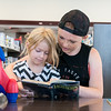 Globe/Roger Nomer<br /> Michaela Harris, 14, Diamond, reads to her sister Brooklynne, 6, on Thursday at the Joplin Public Library.