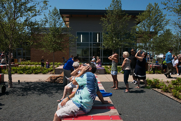 Globe/Roger Nomer<br /> Light dims as the solar eclipse reaches its peak on Monday at the Joplin Public Library.