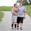 From the left: Brother Noah Danielson, 11 and sister Kelly Danielson, 12, enjoy a little sibling bonding time as they walk the trail through Landreth park on Thursday evening.<br /> Globe | Laurie Sisk