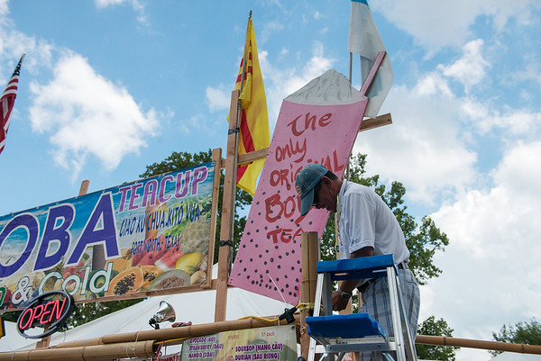 Globe/Roger Nomer<br /> Tam Nguyen, Ft. Worth, Texas, prepares a food booth at Marian Days on Tuesday in Carthage.
