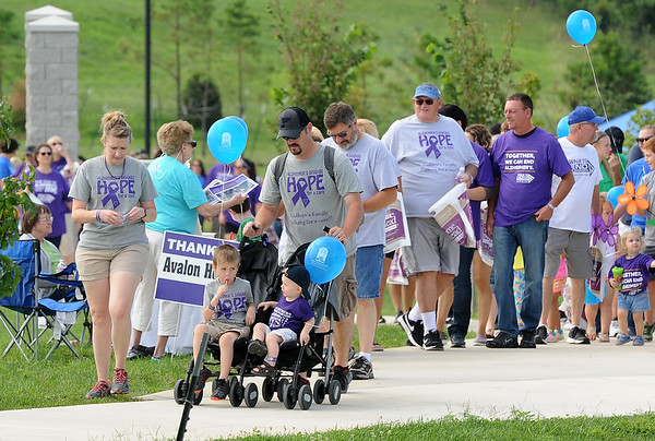 Participants walk the course on Saturday during the 2017 Walk to End Alzheimers at Mercy Park. The event takes place each year in more than 600 cities nationwide and is the largest fundraiser for Alzheimers research and awareness.<br /> Globe | Laurie Sisk