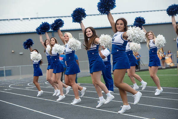 Globe/Roger Nomer<br /> Cheerleaders lead the crowd in the Carthage Tiger Fight Song on Monday before the ribbon cutting at David Haffner Stadium in Carthage.