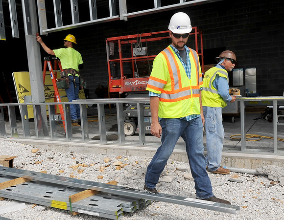 Eric Parker, apprenticeship coordinator for the Carpenter's Union Local 311, walks along the construction site of the new Windsor Foods plant on East 32nd street on Wednesday. Parker said right to work laws are hurting workers and residents of states where they have been enacted.<br /> Globe | Laurie Sisk