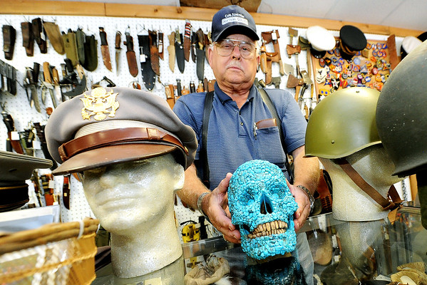 "Longtime collector W.G. ""Trip"" Triplett, of Circle T Collectibles in Carl Junction, holds ""Skully,"" a skull encrusted with seafoam turqouise crafted by a Najavo Indian somewhere between 1880 and 1920. Triplett began collecting Native American and military artifacts 71 years ago and has countless items at his store and his home.<br /> Globe 