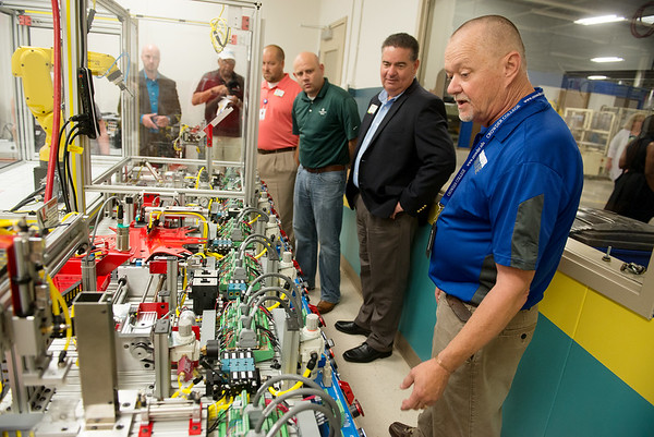 Globe/Roger Nomer<br /> Andy Wilson, right, advanced manufacturing instructor with Crowder College, talks about the mechatronics trainer on Friday at the Joplin Area Chamber of Commerce Advanced training and Technology Center.