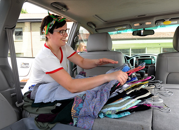 Emily Martin, of Fort Scott,  gathers her last armful of clothes as she moves into the residence halls at Ozark Christian College on Friday. Watson is preparing for her junior year as a biblical communication major at OCC.<br /> Globe | Laurie Sisk