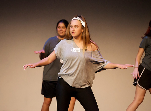 "Globe/Roger Nomer<br /> Mesa Jones, sophomore, practices a dance routine on Monday during rehearsal for ""All Shook Up"" at Pittsburg's Memorial Auditorium."