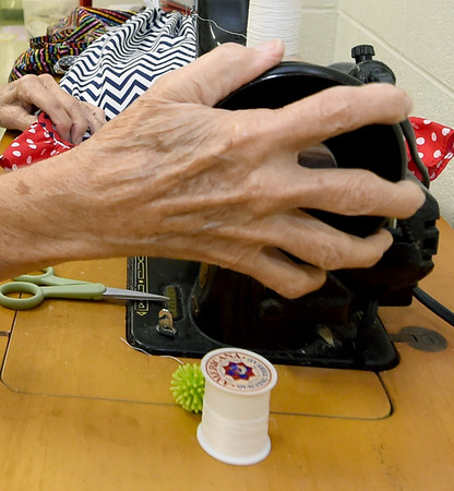 Carol McCombsuses an old Singer sewing machine to make skirts to be shipped to girls in a Haitian orphanage on Thursday at First United Methodist Church in Carthage. The skirts were sewn by about two dozen volunteers.<br /> Globe | Laurie SIsk