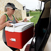 Meals on Wheels volunteer Diana Martin loads cold items for delivery on Thursday at the Joplin Senior Center.<br /> Globe | Laurie Sisk