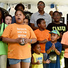 Members of the Joplin Community Youth Choir join in celebration of their faith as they entertain visitors during Park Days on Friday night at Ewert Park. The choir - under the direction of Shiloh Baptist Church's Mikesia Holder, showcases the talents of children from several local churches.<br /> Globe   Laurie Sisk