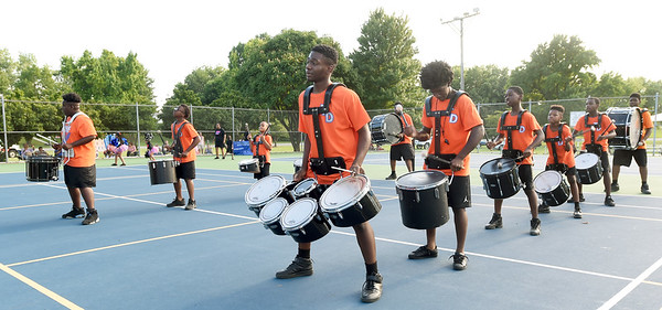 The Kansas City Marching Falcons perform for the crowd on Saturday night during Park Days at Ewert Park. The popular band has performed at Mardi Gras in  New Orleans and Dance Parade in New York City in addition to other top venues.<br /> Globe | Laurie Sisk