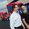 Mike Hinz, CFI vice president, left, talks with Michael Slack, CFI driver and US Navy veteran, on Tuesday at CFI.<br /> Globe | Roger Nomer