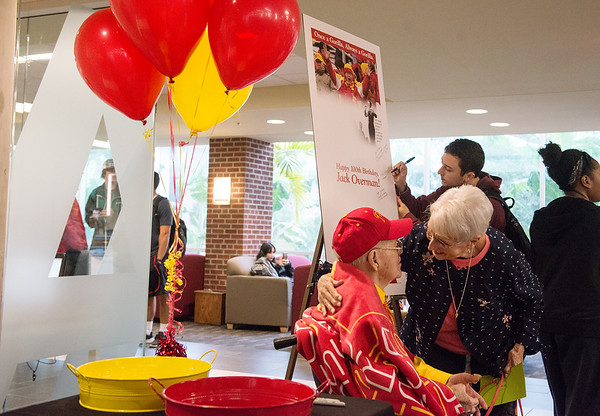 Cathy Aubuchon, Pittsburg, greets Jack Overman during his 100th birthday celebration on Thursday at the Overman Student Center.<br /> Globe | Roger Nomer