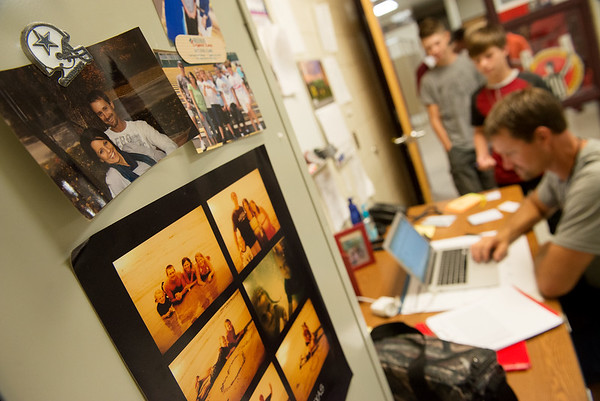 Jason Vieselmeyer keeps family photos on the wall of his office at North Middle School. Jason's wife Jeni also teaches at the school.<br /> Globe | Roger Nomer