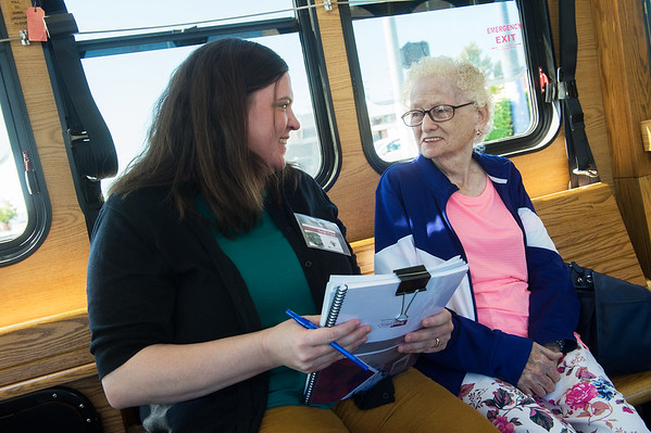 Sarah Frost, with TranSystems, talks with May Halverson while riding the trolley on Wednesday.<br /> Globe | Roger Nomer