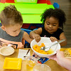 Kaenan Shaw, 3, and Ka-Niyah Bishop, 3, take a snack break at Midtown Head Start on Wednesday.<br /> Globe | Roger Nomer