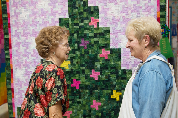 Quilting partners Joan Westhoff, left, and Debbie Potter catch up at the Little Balkans Days Quilt Show at Pittsburg's Memorial Auditorium on Friday in Pittsburg.<br /> Globe | Roger Nomer