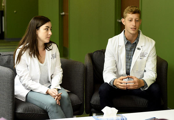 From the left: On Wednesday at Kansas City University, second-year KCU students Annie Altschul, of Charlotte, N.C., and Charles Coker, of Edmond, Okla., talk about the experience they have gained working at the Community Clinic of Southwest Missouri.<br /> Globe | Laurie Sisk