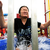 Joplin Police Department Explorer Mykayla Swearngin braces for a cold plunge as she volunteers for the dunk tank on Tuesday night during the National Night Out at Schifferdecker Park.<br /> Globe | Laurie Sisk