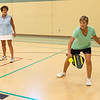 LeighAnn Hackney, left, and Rita Moore play a game of Pickleball at the Carl Junction Community Center on Tuesday. The center is open for Pickleball every Tuesday, Thursday and Sunday afternoon.<br /> Globe | Roger Nomer