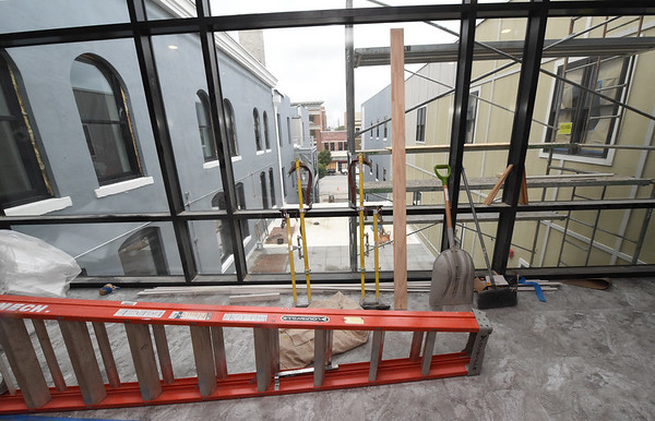 A walkway between the National Bank Building and the Opera House gives a view of the courtyard and downtown Pittsburg.<br /> Globe | Laurie SIsk