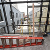 A walkway between the National Bank Building and the Opera House gives a view of the courtyard and downtown Pittsburg.<br /> Globe   Laurie SIsk