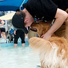 Austin Hutchcroft pets his dog Samson on Saturday during the Doggie Dive In at Ewert Park.