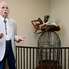 Carthage artist Larry Glaze presents a one-of-a-kind original sculpture to the Joplin Humane Society on Saturday. The sculpture will be a permanent fixture near the shelter's donor wall.<br /> Globe   Laurie Sisk