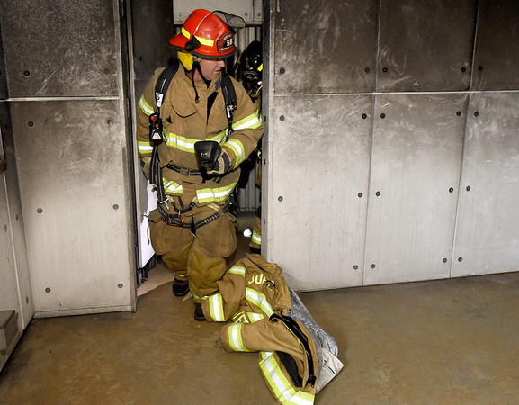 Joplin Fire Department Driver Rob Johnson searches for a downed firefighter during training drills on Thursday at the Joplin Public Safety Training Center.<br /> Globe | Laurie Sisk