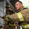 From the left: Joplin firefighters Baylor Smith and Stephen Miller await their turn at a training exercise on Thursday at the Joplin Public Safety Training Center.<br /> Globe | Laurie Sisk