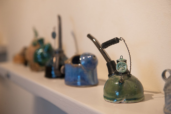 Angel Brome's teapots are number to mark the day they were created.<br /> Globe | Roger Nomer