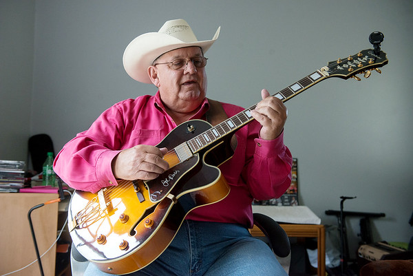 Dewayne Bowman plays a song at his home in Stark City on Wednesday.<br /> Globe | Roger Nomer