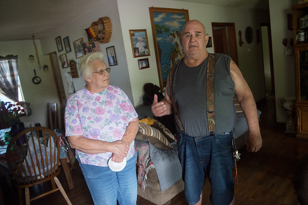 Dorothy Humphrey and her tenant Vurl Brock talk about flooding damage at her property on Friday in Neosho.<br /> Globe | Roger Nomer