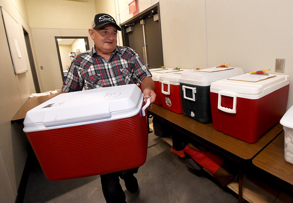 Joplin Senior Center custodian Kenny Youngblood organizes coolers of cold items for delivery to Meals on Wheels clients on Thursday at the center.<br /> Globe   Laurie Sisk