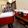 Joplin Senior Center custodian Kenny Youngblood organizes coolers of cold items for delivery to Meals on Wheels clients on Thursday at the center.<br /> Globe | Laurie Sisk