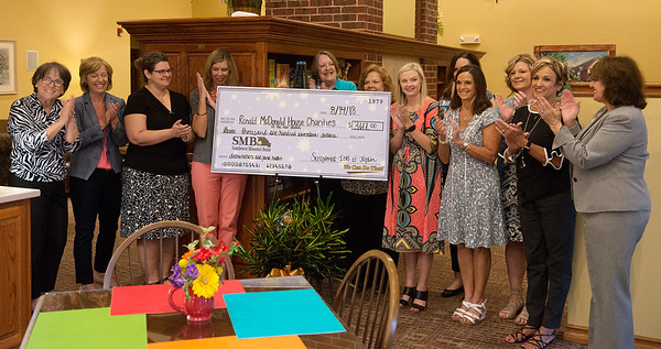 Soroptimist International of Joplin present a check for $3,617 to Ronald McDonald House Charities of the Four States for dishwashers and a panic button security system on Tuesday morning.<br /> Globe | Roger Nomer