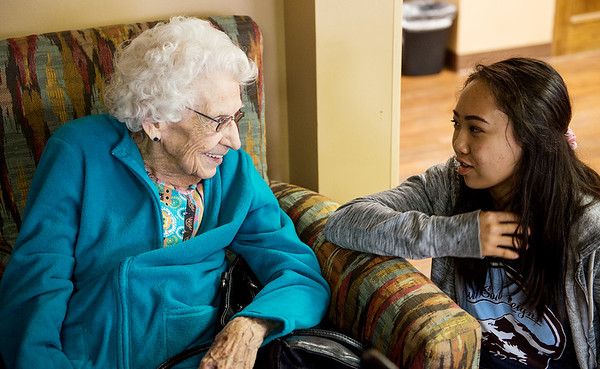 Maddie Jones, College Heights junior, talks with Beatrice Fleener during a visit to Spring River Christian Village on Monday morning.<br /> Globe | Roger Nomer