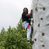 Armahri Brown, a Missouri Southern freshman from South Holland, Ill., climbs a rock wall during Monday's Welcome Back Picnic on the campus oval.<br /> Globe | Roger Nomer