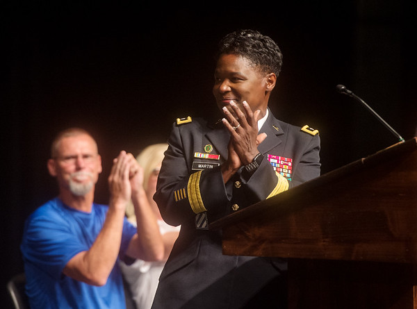 Major Gen. Donna Martin leads a round of applause for the Joplin High JROTC program for its more than one hundred years of service during Monday's back-to-school rally at Joplin High School.<br /> Globe | Roger Nomer