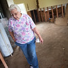 Dorothy Humphrey takes a tour of some of her flood-damaged property in Neosho on Friday.<br /> Globe | Roger Nomer