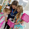 Kenzie, left, and Kelli Welshofer get a hug from Kelly Holt, kindergarten teacher at Cecil Floyd before their first day of kindergarten and third grade on Thursday.<br /> Globe | Roger Nomer