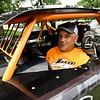 Racecar driver Chris Hawkins stands beside his racecar at his rural Neosho home on Friday.<br /> Globe | Laurie Sisk