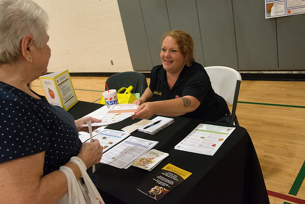Trixie Woods, Lamar, left, chats with Nicole Sparkman, with the University of Missouri Extension Office Family Nutrition Education Program, on Tuesday at the Fair Acres Family YMCA in Carthage during the National Senior Day Expo.<br /> Globe | Roger Nomer